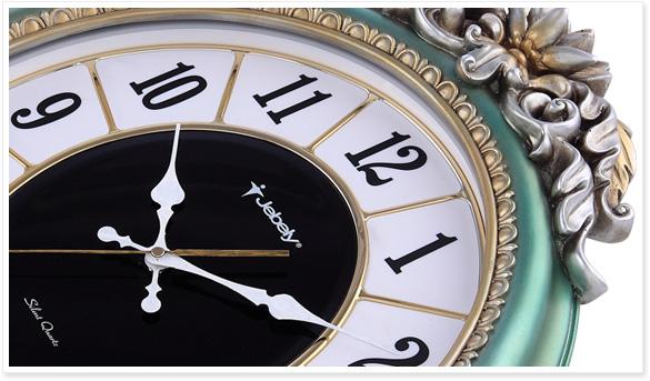 产品特点:采用静音铃木机芯,高档刷水绿漆树脂外框,精美立体雕花,简约钟面,活灵活现的鸳鸯雕像。 适合人群:大众化人群都可以选择使用 适合场景:高档大厅,客厅,卧室,书房,酒店,会所等场所 JB821-B高档POLY挂钟尺寸图:  JB821-B高档POLY挂钟实物展示:  【正面】 【背面】  【侧面】  【侧面】 JB821-B高档POLY挂钟细节图: